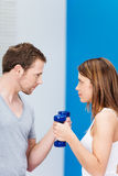 Competitive young couple working out at the gym Stock Images