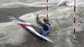 Competitor in canoe slalom race Royalty Free Stock Image