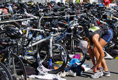 Competitor changing running shoes in event. Stock Image