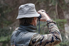 Competitor checking target before shooting Stock Images