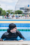 Competitor Getting ready by Doing a Wet Warm-up Royalty Free Stock Photos