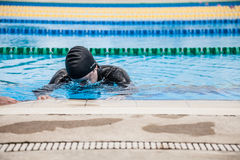 Competitor Getting ready by Doing a Wet Warm-up Stock Images