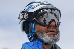 Competitor on randonnee race. A competitor on a randonnée ski race with frost on the beard and mustache royalty free stock photography