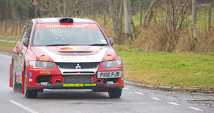 Competitor in Snowman Rally 2012. An image of a competitor in the 2012 Snowman Rally. The car is  a Mitsibishi Lancer EVO 912 is  seen approaching Drumnadrochit Stock Photos