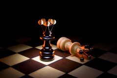 Competitors. Chessmen (black and white a queen). A dark art background Stock Photo