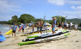 Competitors assembling on beach Stock Photo