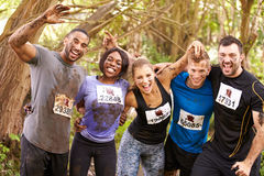 Competitors celebrate completing an endurance sports event Royalty Free Stock Images