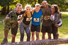 Competitors celebrate completing an extreme endurance event Royalty Free Stock Image