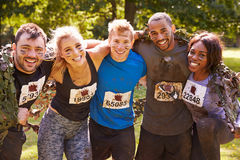 Competitors celebrate completing an extreme endurance event Royalty Free Stock Photo