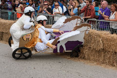 Competitors Crash Vehicle Into Hay Bales At Soap Box Derby Royalty Free Stock Photography