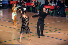 Competitors dancing latin dance on the conquest Royalty Free Stock Photography
