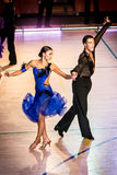 Competitors dancing latin dance on the conquest Stock Images