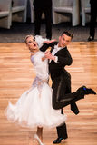 Competitors dancing slow waltz or tango Stock Images