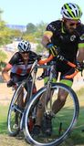 Competitors on pro cycling course Royalty Free Stock Images