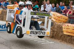 Competitors Racing Bus Vehicle Get Airborne At Soap Box Derby Royalty Free Stock Images