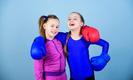 Competitors on ring and friends in life. Girls in boxing sport. Boxer children in boxing gloves. Confident teens. Female royalty free stock photography