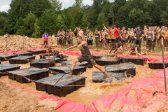 Competitors Run Across Floating Platforms At Extreme Obstacle Course Race Stock Images