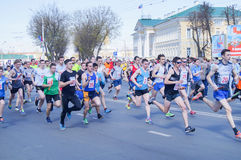 Competitors running in a city an endurance event Stock Image