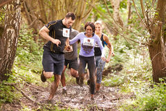 Competitors running in a forest at an endurance event Royalty Free Stock Photo