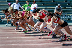 Competitors on start of 100 m women Royalty Free Stock Image