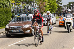 Competitors and teams in Giro d'Italia 2010. DELFGAUW, NETHERLANDS - MAY 10: Competitors and following teams in the Giro d�Italia passing by on a polderroad Stock Image