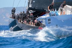Competitors during Wally class regatta in mallorca. Splashes during Wally sailing maxi class ships compete during their regatta at Palmavela sailing race in Stock Photography
