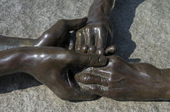 Compilação escultural - quatro mãos conectadas junto Fotos de Stock Royalty Free