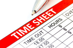 Compiled Time sheet with a pen. Business concept Stock Images