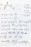 Compito scritto a mano di fisica Fotografie Stock