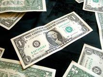 Complètement du dollar américain d'argent sur le noir Photos stock