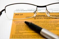 Compléter la déclaration d'impôt polonaise Image stock