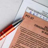 Compléter la feuille d'impôt individuelle polonaise PIT-37 pendant l'année 2013 Image stock