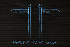 Complain or Fix It road signs, options to face an issue. Reaction to an issue concept: alternative road signs pointing at opposite directions with options Royalty Free Stock Photography