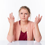 Complaining young blond woman expressing herself with angry hands up Royalty Free Stock Photo