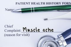 Complaint of muscle ache. Paper health history form, which is written on the patient`s chief complaint of muscle ache, surrounded Royalty Free Stock Images