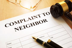 Complaint to neighbor on a table. Stock Image