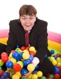 Compleanno dell'uomo d'affari con la sfera. Immagine Stock