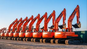A complect of new excavators sold and parked royalty free stock photos