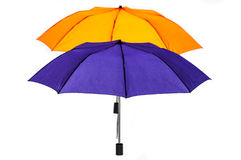 Complementary colored umbrellas isolated white Stock Photo