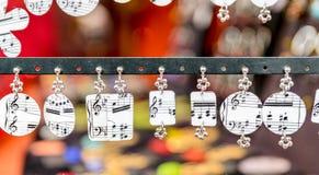 Complementos con las notas musicales Imagenes de archivo