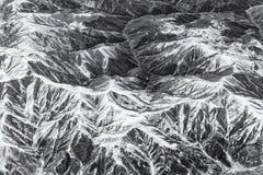 Complesso delle montagne vedute dall'aria Immagine Stock