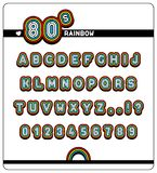 Complete alphabet and numbers in 80s Rainbow Font. Complete alphabet and numbers with question and exclamation marks of a 1980s Rainbow Font with colorful digits Royalty Free Stock Photo