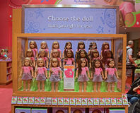 Complete American Girl Dolls set on Display. Complete American Girl Doll characters set on Display in the Fifth Avenue boutique store in New York City. The Stock Image