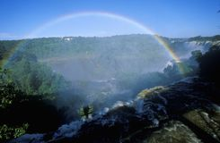 Complete arch rainbow over Iguazu Waterfalls in Parque Nacional Iguazu, border of Brazil and Argentina Stock Images