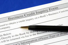 Complete the credit inquiry form. Isolated on blue Royalty Free Stock Image