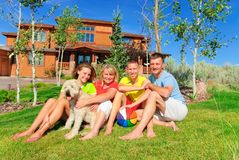 Complete family. With dog by their home Royalty Free Stock Photos