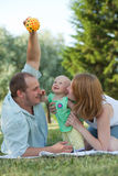 Complete family. Family of three people walking in the park Stock Photo