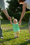 Complete family. Family of three people walking in the park Stock Image