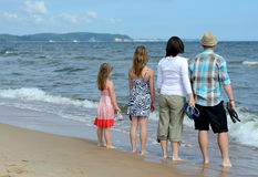 Complete family enjoying sea landscape. Happy family on summer beach Stock Photography