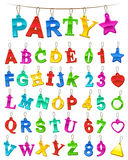 Complete festive alphabet and numbers set with blank labels. Complete colorful festive alphabet and numbers set in the colors of the rainbow designed as hanging Stock Photos